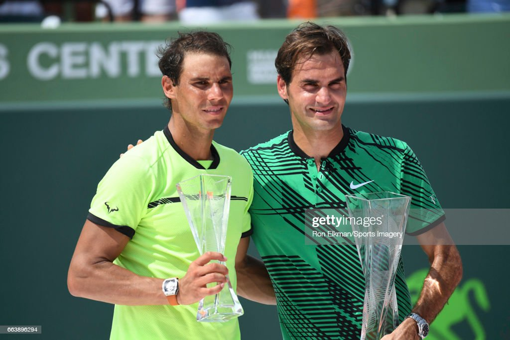 Winner Roger Federer of Switzerland and runner-up Rafael Nadal of Spain hold their trophies after the Men's Final at Crandon Park Tennis Center on April 2, 2017 in Key Biscayne, Florida