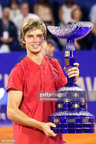 Winner Russian tennis player Andrey Rublev poses with his trophy during the prize ceremony after competing in the ATP Croatia Open tennis tournament...