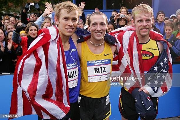 Winner Ryan Hall second place finisher Dathan Ritzenhein and third place finisher Brian Sell pose for photographs during the US Olympic Team Trials...