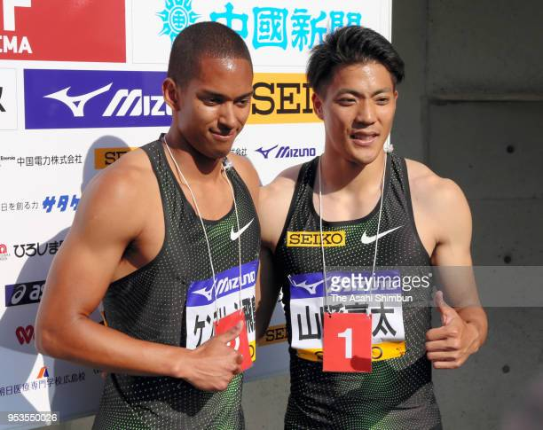 Winner Ryota Yamagata and runnerup Aska Cambridge pose for photographs after competing in the Men's 100m during the 52nd Oda Memorial Meet at Edion...