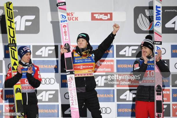 Winner Ryoyu Kobayashi of Japan celebrates between second placed Stefan Kraft of Austria and third placed Andreas Stjernen of Norway on day 6 of the...