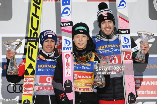 Winner Ryoyu Kobayashi of Japan poses with second placed Stefan Kraft of Austria and third placed Andreas Stjernen of Norway on day 6 of the 67th FIS...