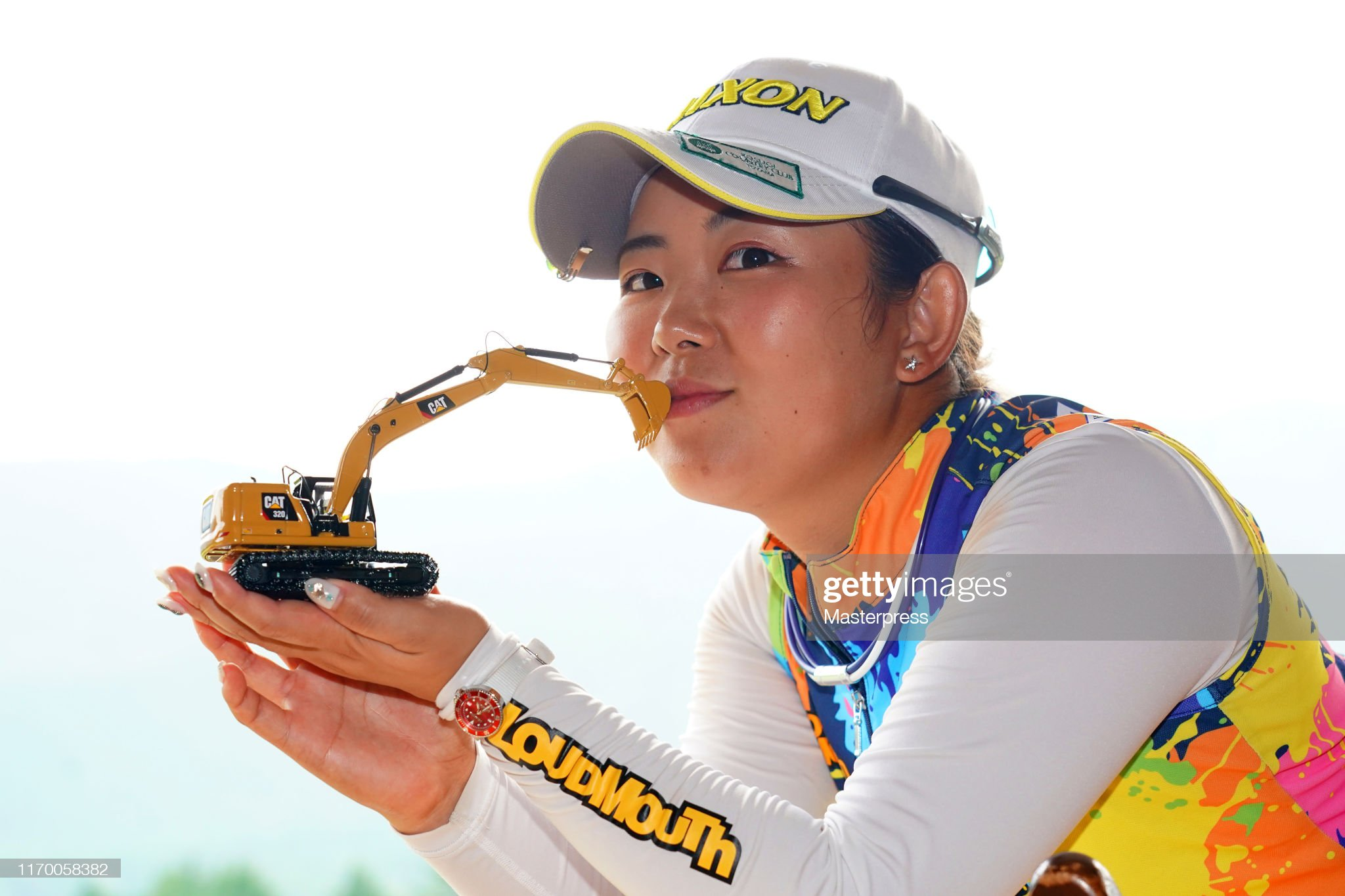 https://media.gettyimages.com/photos/winner-saki-asai-of-japan-poses-with-a-model-of-a-caterpillar-power-picture-id1170058382?s=2048x2048