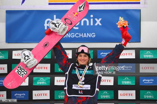 Winner Scotty James of Australia celebrates during the award ceremony after the men's halfpipe final in the FIS Snowboard World Cup at Phoenix Snow...