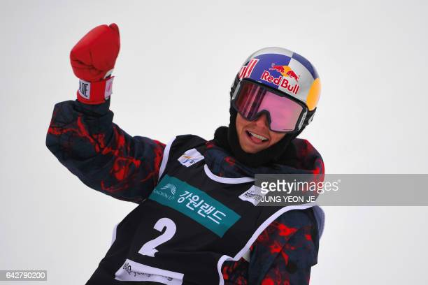 Winner Scotty James of Australia celebrates during the men's halfpipe final in the FIS Snowboard World Cup at Phoenix Snow Park in Pyeongchang on...