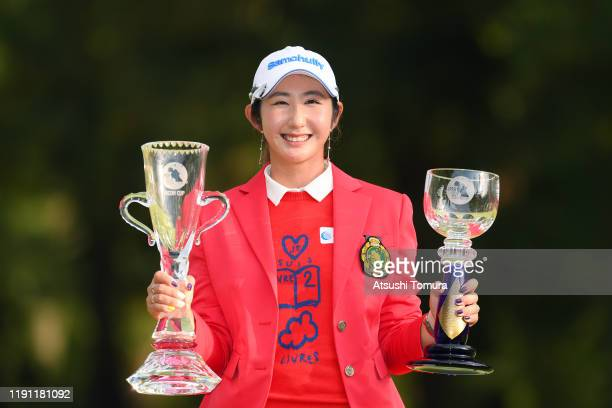 Winner Seonwoo Bae of South Korea poses with the trophies after the final round of the LPGA Tour Championship Ricoh Cup at Miyazaki Country Club on...