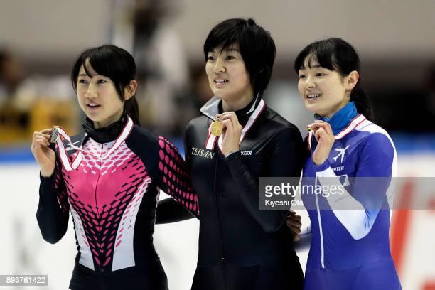 Winner Shione Kaminaga celebrates with runnerup Aoi Watanabe and thirdplaced Yuki Kikuchi at the award ceremony for the Ladies' 1500m competition...