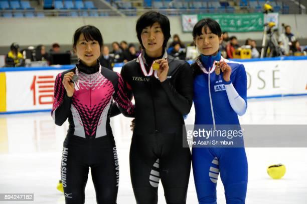 Winner Shione Kaminaga celebrates with runnerup Aoi Watanabe and thirdplaced Yuki Kikuchi at the award ceremony for the Ladies' 1500m during day one...