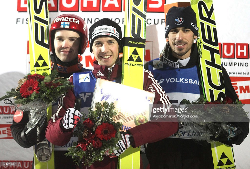 Winner Simon Ammann (C) of Switzerland poses on the Podium together with Harri Olli (L) of Finland who placed second and Emmanuel Chedal (R) of France who placed third in the Ski Jumping HS 138 event during day two of the FIS World Cup on December 6, 2009 in Lillehammer, Norway.