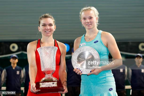 Winner Simona Halep of Romania and runnerup Katerina Siniakova of the Czech Republic pose with their trophies after the final match on Day 7 of 2018...