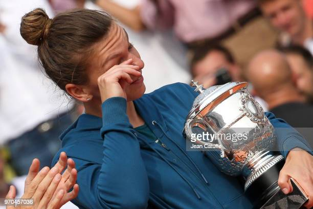 Winner Simona Halep of Romania celebrates winning the French Open during the trophy ceremony on Day 14 of the 2018 French Open at Roland Garros...