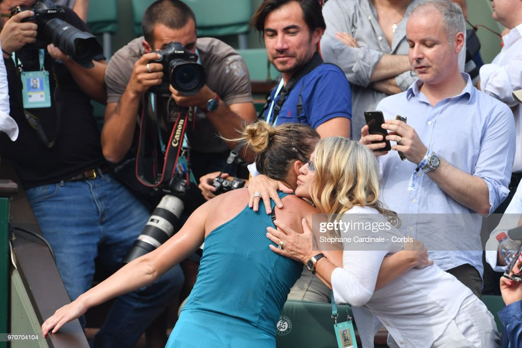 Winner Simona Halep of Romania is greeted by Nadia Comaneci in the stands after winning the French Open final on Day 14 of the 2018 French Open at Roland Garros on June 9, 2018 in Paris, France.