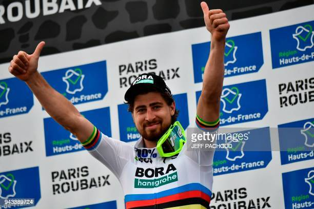 Winner Slovakia's Peter Sagan celebrates on the podium after the 116th edition of the ParisRoubaix oneday classic cycling race between Compiegne and...