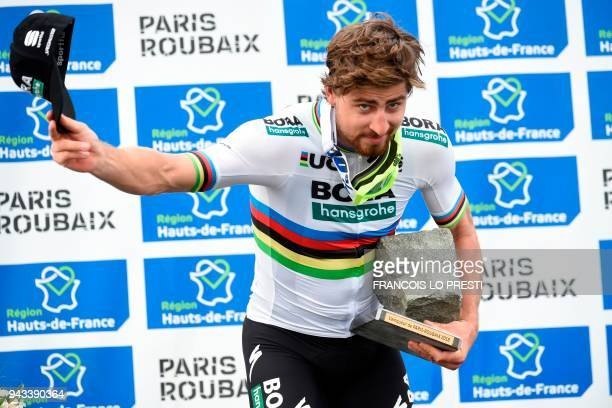 Winner Slovakia's Peter Sagan celebrates with his trophy on the podium after the 116th edition of the Paris-Roubaix one-day classic cycling race,...