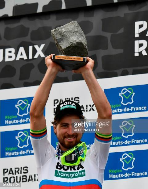 Winner Slovakia's Peter Sagan celebrates with his trophy on the podium after the 116th edition of the ParisRoubaix oneday classic cycling race...