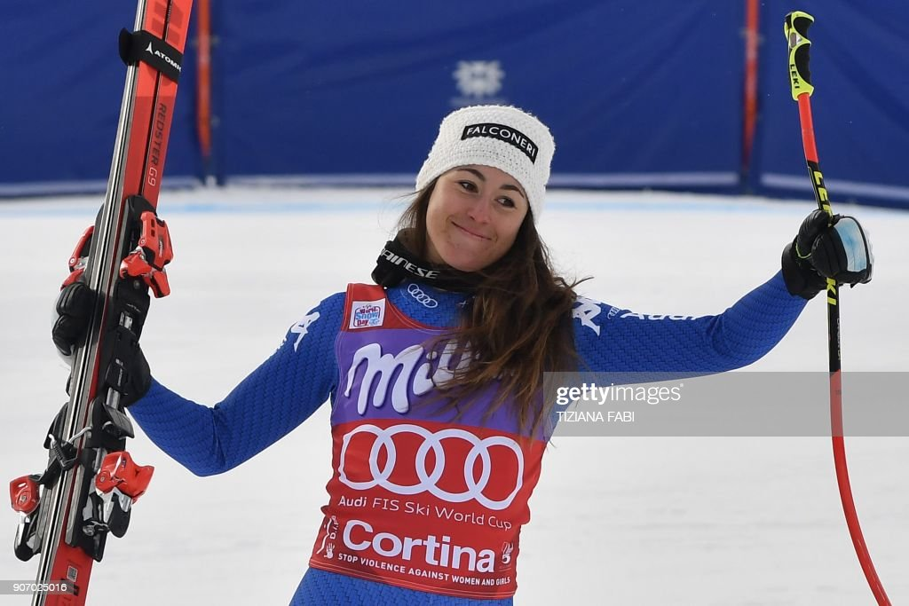 Winner Sofia Goggia of Italy celebrates during the podium ceremony of the FIS Alpine World Cup Women's Downhill replacing Val d'Isere event on January 19, 2018 in Cortina d'Ampezzo, Italian Alps. Italy's Sofia Goggia won the downhill on home snow at Cortina d'Ampezzo on Friday, her second victory in as many weeks on the women's World Cup circuit. Goggia followed her downhill triumph at Bad Kleinkirchheim in Austria last week by winning here in 1min 36.45sec, a margin of 0.47sec ahead of Lindsey Vonn. Vonn's fellow American star Mikaela Shiffrin was third, 0.84sec behind the winner. PHOTO / Tiziana FABI