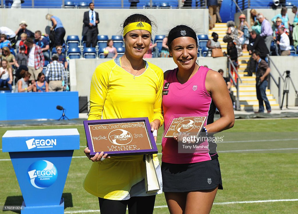 Winner Sorana Cirstea (L) of Romania and runner up Heather Watson of Great Britain pose with their Cadbury World plaques after their mixed doubles exhibition match with respective partners Greg Rusedski and Tim Henman of Great Britain during day one of the AEGON Classic tennis tournament at Edgbaston Priory Club on June 9, 2013 in Birmingham, England.