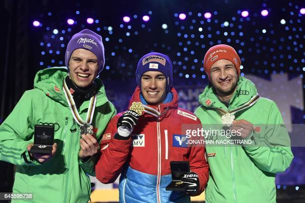Winner Stefan Kraft of Austria 2nd placed Andreas Wellinger of Germany and 3rd placed Markus Eisenbichler of Germany pose for photographers during...
