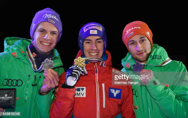 Winner Stefan Kraft of Austria 2nd placed Andreas Wellinger of Germany and 3rd placed Markus Eisenbichler of Germany pose with their medals during...