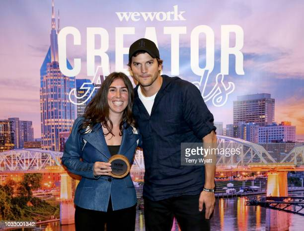 Winner Stephanie Benedetto of Queen of Raw and Ashton Kutcher take photos during the Nashville Creator Awards hosted by WeWork at Marathon Music...