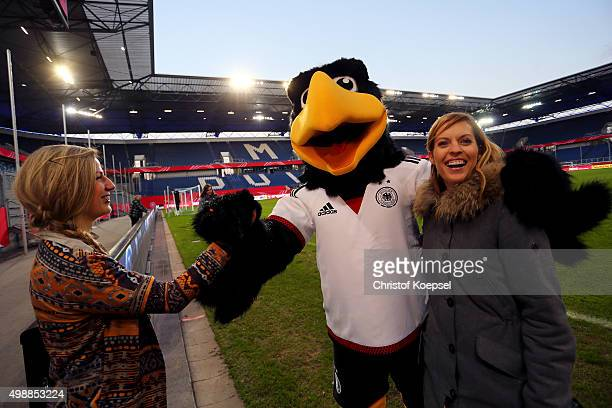 Winner Stephanie Schwehm mascot Paule and Jule Goelsdorf DFBTV moderator seen during the Meet and Greet of the Fanclub Nationalmannschaft prior to...