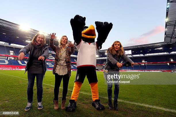 Winner Stephanie Schwehm mascot Paule and Jule Goelsdorf DFBTV moderator celebrate during the Meet and Greet of the Fanclub Nationalmannschaft prior...