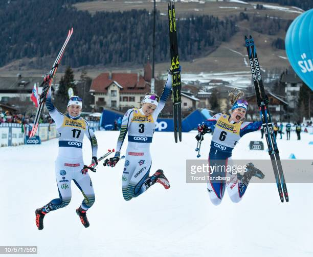 Winner Stina Nilsson of Sweden celebrates with Ida Ingemarsdotter of Sweden Jessica Diggins of USA after Tour de Ski Ladies 13 Sprint Free on...