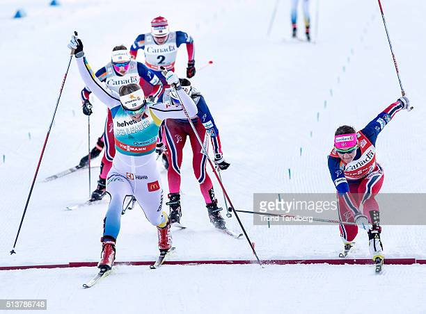 Winner Stina Nilsson of Sweden crosses the finish line ahead of Maiken Caspersen Falla of Norway during Cross Country Ladies 15 km Sprint Free...
