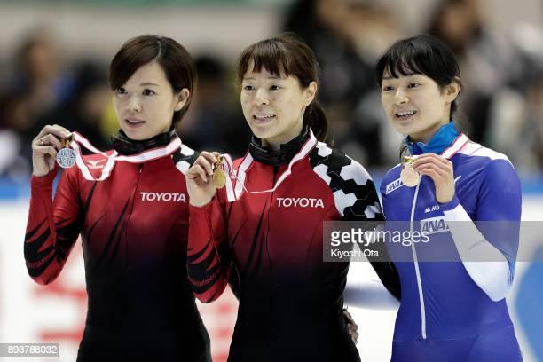 Winner Sumire Kikuchi celebrates with runnerup Ayuko Ito and thirdplaced Yuki Kikuchi at the award ceremony for the Ladies' 500m competition during...