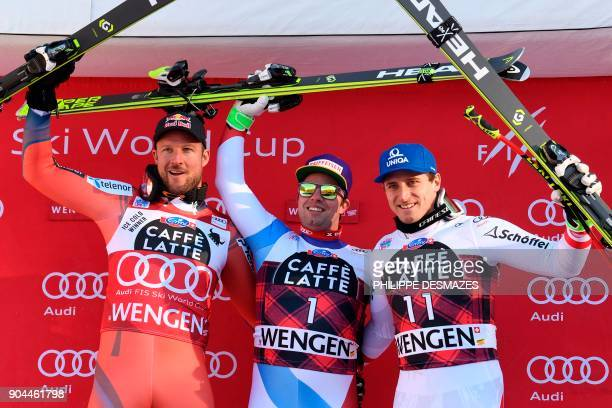 Winner Switzerland's Beat Feuz secondplaced Norway's Aksel Lund Svindal and thirdplaced Austria's Matthias Mayer celebrate on the podium after the...