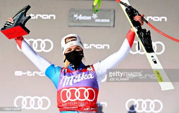 Winner Switzerland's Lara Gut-Behrami poses on the podium after the women's Super G event of the FIS Alpine Ski World Cup on January 10 in St Anton,...