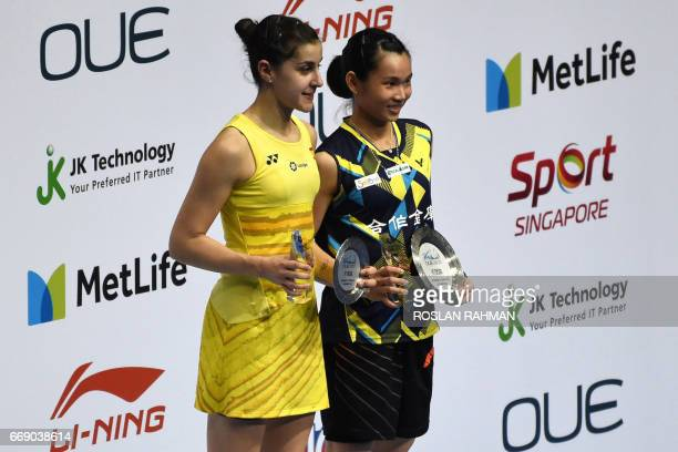 CORRECTION Winner Tai TzuYing of Taiwan poses on the podium with secondplaced Carolina Marin of Spain after their women's singles final of the...