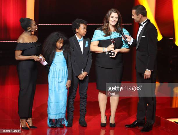 Winner Tanja Hock her children and dancer Motsi Mabuse and German presenter Kai Pflaume pose during the 'Goldene Bild der Frau' awarding ceremony on...
