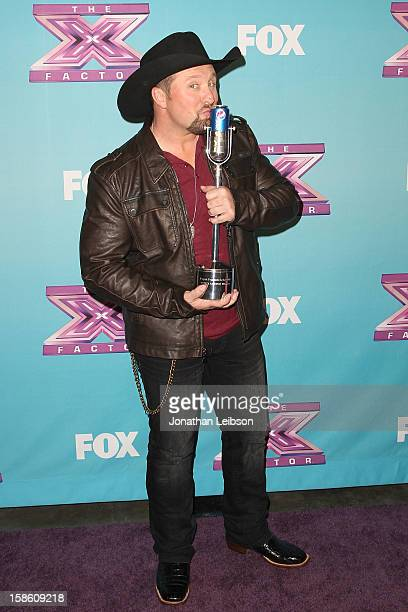 Winner Tate Stevens celebrates at the FOX's 'The X Factor' Season Finale Night 2 at CBS Television City on December 20 2012 in Los Angeles California