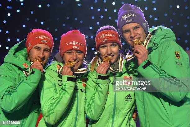 Winner team from Germany Markus Eisenbichler Carina Vogt Svenja Wuerth and Andreas Wellinger pose for photographers during the medals ceremony for...
