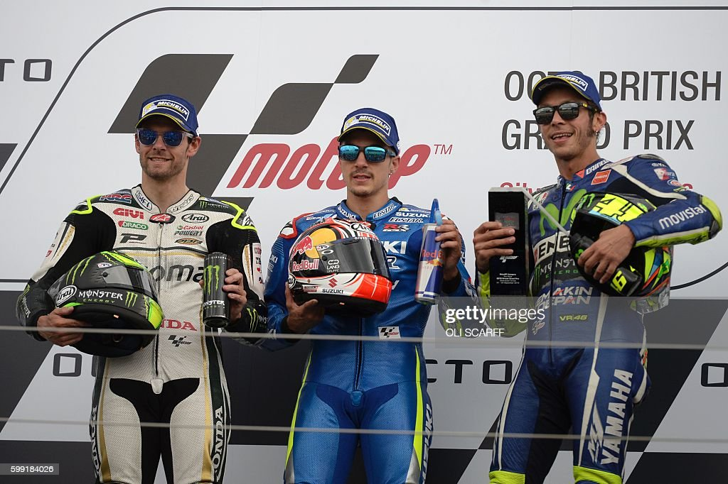 Winner Team Suzuki ECSTAR Maverick Vinales (C), second-placed LCR Honda's British rider Cal Crutchlow (L) and third-placed Movistar Yamaha MotoGP's Italian rider Valentino Rossi (R) pose on the podium after the MotoGP race at the motorcycling British Grand Prix at Silverstone circuit in Northamptonshire, southern England, on September 4, 2016. / AFP / OLI