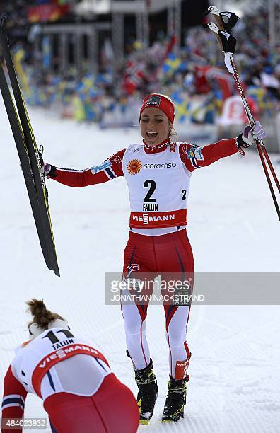Winner Therese Johaug of Norway and second placed Astrid Uhrenholdt Jacobsen of Norway react at the finish line of the ladies crosscountry skiathlon...