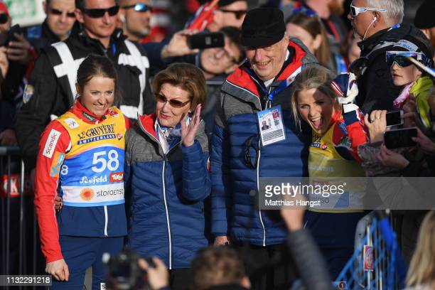 Winner Therese Johaug of Norway and third placed Ingvild Flugstad Oestberg of Norway celebrate with Queen Sonja of Norway and King Harald V of Norway...