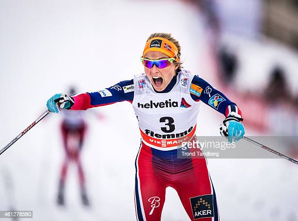 Winner Therese Johaug of Norway celebrates during the Lady 10 km Mass Start Classic Tour de Ski on January 10 2015 in Val di Fiemme Italy