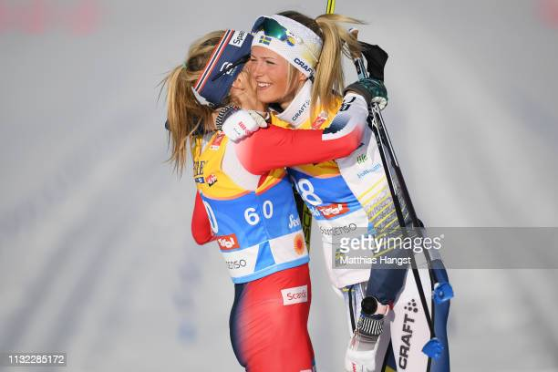 Winner Therese Johaug of Norway celebrates with second placed Frida Karlsson of Sweden during the CrossCountry Women's 10k race of the FIS Nordic...