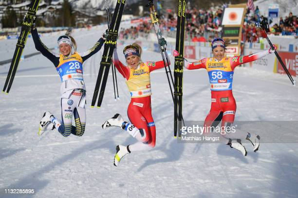 Winner Therese Johaug of Norway celebrates with second placed Frida Karlsson of Sweden and third placed Ingvild Flugstad Oestberg of Norway after the...