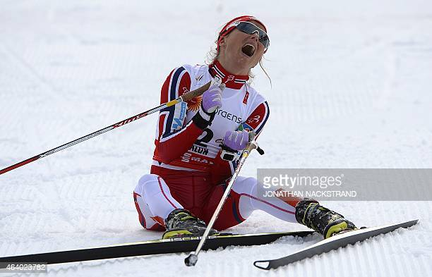 Winner Therese Johaug of Norway reacts at the finish line of the ladies crosscountry skiathlon 75 km classic and 75 km free race during the 2015 FIS...