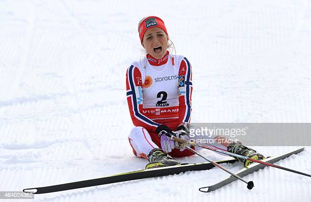 Winner Therese Johaug of Norway reacts at the finnish line after the ladies crosscountry skiathlon 75 km classic and 75 km free race during the 2015...