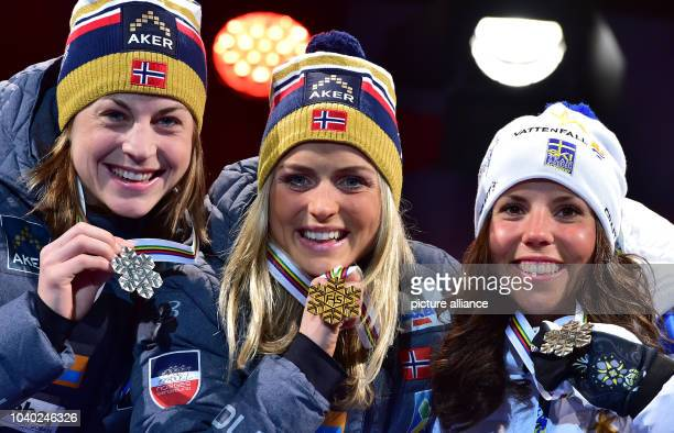 Winner Therese Johaug of Norway second placed Astrid Uhrenholdt Jacobsen of Norway and third placed Charlotte Kalla of Sweden celebrate during the...