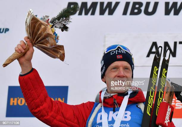 Winner Thingnes Johannes Boe of Norway celebrates on the podium of the Men's 10km sprint competition of the IBU World Cup Biathlon in Anterselva on...