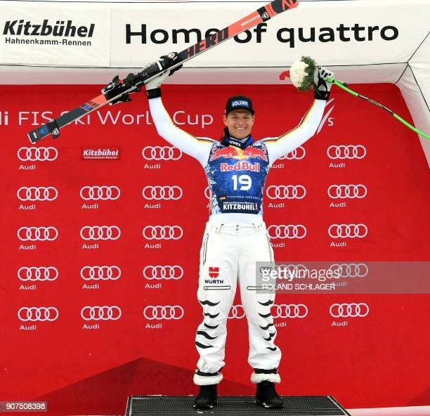 Winner Thomas Dressen of Germany celebrates on the podium after the men's downhill event at the FIS Alpine World Cup in Kitzbuehel Austria on January...