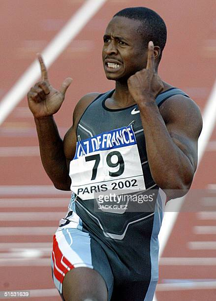 US winner Tim Montgomery jubilates after winning the men's 100m race in 978 and setting a new world record 14 September 2002 during the IAAF...