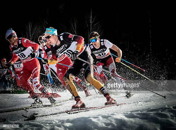 Winner Tim Tscharnke of Germany Dieter Noeckler of Italy Max Hauke of Austria during Men 15 km Mass Start Classic Tour de Ski on January 10 2015 in...