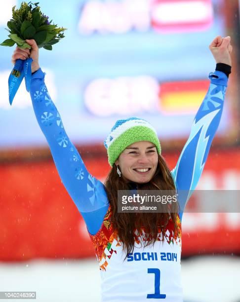 Winner Tina Maze of Slovenia celebrates during the flower ceremony for the Women's Giant Slalom Alpine Skiing event at the Rosa Khutor Alpine Center...