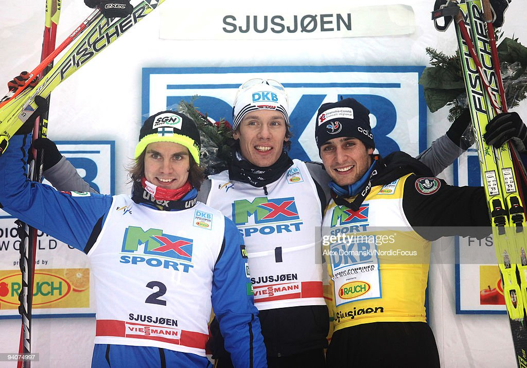 Winner Tino Edelmann (C) of Germany poses on the Podium together with Anssi Koivuranta (L) of Finland who placed second and Jason Lamy-Chappuis (R) of France who placed third incompetes in the Gundersen 10km event during day two of the FIS Nordic Combined World Cup on December 6, 2009 in Lillehammer, Norway.